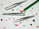 Craft tweezers and tiny eyelets, brads, and pieces of paper